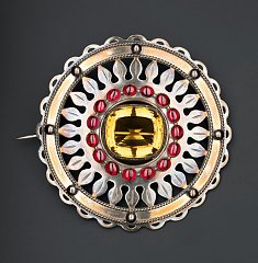 Click image for larger version.  Name:silver-plaid-brooch-set-with-a-cairngorm-in-the-centre-and-a-ring-of-sixteen-carbuncles-round-it.jpg Views:15 Size:190.3 KB ID:37016